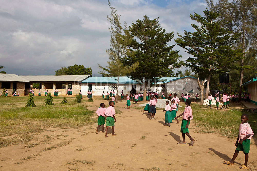 Children in the playground of Mari Mani primary School, Mombassa, Kenya.  The school is supported by Wema, a NGO organisation supporting vulnerable children.  The school has 807 pupils and 16 teachers.