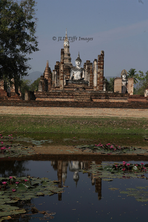 Sukothai, Wat Mahathat seen from across a pond in which it is partly reflected