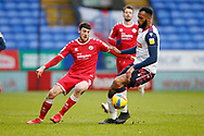 Crawley Town's Ashley Nadesan goes past Bolton Wanderers Reiss Greenidge(16) during the EFL Sky Bet League 2 match between Bolton Wanderers and Crawley Town at the University of  Bolton Stadium, Bolton, England on 2 January 2021.