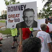 Protesters march in a parade during the Republican National Convention in Tampa, Fla. on Wednesday, August 29, 2012. (AP Photo/Alex Menendez)