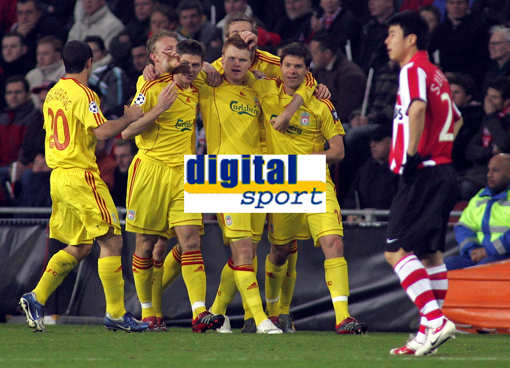 Photo: Paul Thomas.<br />PSV Eindhoven v Liverpool. UEFA Champions League, Quarter Final, 1st Leg. 03/04/2007.<br /><br />John Arne Riise of Liverpool celebrates his goal with team-mates.