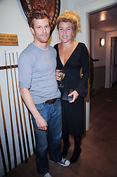 TOM & AMBER AIKENS at a party to celebrate the publication of Born Wild by Tony Fitzjohn at The Arts Club, Dover Street, London on 16th September 2010.