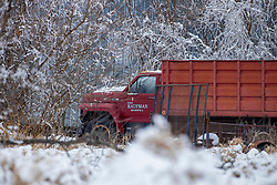An old grain truck belonging to farmer Earl Kaufman of Heyworth IL sits in an icy and snowy barn lot in rural Heyworth