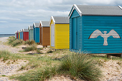 Colourful beach huts on beach at Findhorn in Moray, Morayshire, Scotland, UK