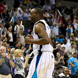 March 30, 2011; New Orleans, LA, USA; New Orleans Hornets power forward Carl Landry (24) celebrates following a win over the Portland Trail Blazers at the New Orleans Arena. The Hornets defeated the Trail Blazers 95-91.   Mandatory Credit: Derick E. Hingle