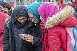 March 22, 2019 - Hamtramck, Michigan, U.S. - Hamtramck, Michigan - Muslim school girls study a cell phone. Hamtramck has always been a city of immigrants, most recently from Muslim countries. Over 30 languages are spoken in the city. (Credit Image: © Jim West/ZUMA Wire)