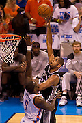 June 2, 2012; Oklahoma City, OK, USA; Oklahoma City Thunder center Kendrick Perkins (5) attempts to block a shot by San Antonio Spurs forward Tim Duncan (21) during the first half of a playoff game at Chesapeake Energy Arena.  Mandatory Credit: Beth Hall-US PRESSWIRE