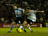 Fotball<br /> England 2004/2005<br /> Foto: SBI/Digitalsport<br /> NORWAY ONLY<br /> <br /> Derby County v Leeds United<br /> Coca Cola Championship. 26/01/2005<br /> <br /> Despite the efforts of Leeds' Frazer Richardson (L) Derby's Tommy Smith (R) breaks away to score his team's first goal.