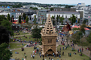 21/07/2018 repro free:  The Galway International Arts Festival Continues til the 29th of July , The  Miracoco Luminarium and Festival Garden continue till the end of the festival , The People Build which is a cardboard replica of St Nicholas' Church was  torn down by The public on Sunday .Pictures: Andrew Downes/Xposure <br /> <br /> FYI<br /> 21/07/2018 repro free:  <br /> The <br /> The People Build at Galway International Arts Festival saw not just one but two large-scale structures appear in a matter of hours built solely from cardboard. Under the guidance of French artist, Olivier Grossetete and his team, The People Build saw over 600 volunteers and members of the general public transform cardboard boxes into a church steeple and a bridge. This spectacular architectural event won the hearts of festival audiences and encouraged a sense of community where everyone could get involved. The structure built at Eyre Square was inspired by St. Nicholas' Church in Galway and the bridge at Waterside was positioned at the location of Galway's River Corrib Viaduct, once part of the famous Galway to Clifden Railway.<br /> <br /> It is estimated that almost 4 tonnes of cardboard were used across the two builds. Following the constructions, children and grown-ups alike joined forces in a massive celebratory demolition, which saw the cardboard structures come tumbling down amidst shrieks of joy and delight.<br /> <br /> Walsh Waste & Recycling have once again joined forces with Galway International Arts Festival to ensure there was no unnecessary waste following the event and were on hand to take away the crushed cardboard to be recycled. Photo:Andrew Downes, xposure
