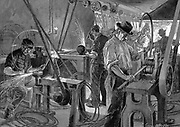 Bicycle Manufacture, France:  Shaping the wheel rims. Machinery all driven from central power source through belt-and-shafting. In right foreground man is passing metal strip through shaping machine, it is then passed along production line to forge at rear.  Men at grindstones wear protective goggles. Fish-tail gas lights provide illumination.  Wood engraving Paris, 1896.