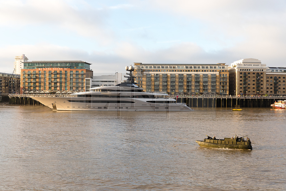 © Licensed to London News Pictures. 24/10/2018. London, UK.  Royal Marines onboard a military vessel ahead of the Thames demonstration for the Dutch Royal State visit today look at the 308 feet long luxury superyacht Kismet, reportedly owned by Pakistani-American billionaire, Shahid Khan, has arrived in London and moored at Butlers Wharf on the River Thames near Tower Bridge. Mr Khan owns the National Football League (NFL) team, the Jacksonville Jaguars, who are due to play the Philadelphia Eagles in an International Series game at Wembley on Sunday 28th October. Kismet has 6 staterooms, with the master bedroom having its own private deck with jacuzzi and helipad.  Photo credit: Vickie Flores/LNP