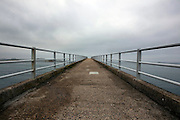 The long pedestrian jetty to the ferry to Isle de Batz, used at low tide. Roscoff, Brittany, France