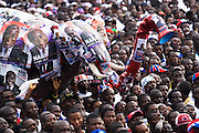 Supporters surround a large fake elephant - the New Patriotic Party's emblem - during a campaign rally in Ghana's capital Accra on Friday December 5, 2008. Thousands of Ghanaians gathered in final rallies as they prepared to head to the polls on Sunday December 7 to elect a new government.