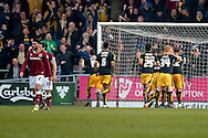 The U's celebrate their equaliser in front of their fans  during the Sky Bet League 2 match between Northampton Town and Cambridge United at Sixfields Stadium, Northampton, England on 12 March 2016. Photo by Dennis Goodwin.