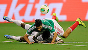 May 31, 2013; Houston, TX, USA; Nigeria defender Godfrey Oboabona (2) and Mexico forward Raul Jiminez (19) collide during the second half at Reliant Stadium. Nigeria and Mexico played to a 2-2 draw. Mandatory Credit: Thomas Campbell-USA TODAY Sports