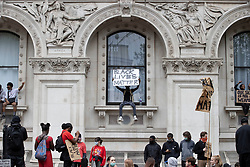 © Licensed to London News Pictures. 03/06/2020. London, UK. Black Lives Matter protesters sit on the windows of the Foreign Office in Whitehall during a demonstration following the death of African American George Floyd while in police custody. The death of George Floyd, who died after being restrained by a police officer In Minneapolis, Minnesota, has caused widespread rioting and looting across the USA. Photo credit: Peter Macdiarmid/LNP