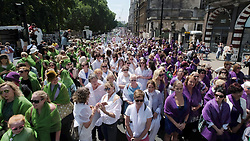 © Licensed to London News Pictures. 10/06/2018. London, UK. Women walk down Piccadilly Circus taking part in Processions, a mass artwork celebrating 100 years of women voting. Photo credit:  Ray Tang/LNP