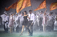 Members of the Celebration Homecoming Court walk on the field during a downpour during halftime of a high school football game against Saint Cloud in Celebration, Fla., Friday, Oct. 2, 2015. (Photo by Phelan M. Ebenhack)