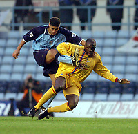 Picture: Henry Browne.<br />Date: 22/11/2003.<br />Coventry City v Gillingham Nationwide Division One.<br /><br />Nyron Nosworthy of Gillingham blocks a shot from Coventry's Youssef Safri