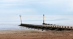 Groynes on the beach at Portobello in Edinburgh, Scotland UK