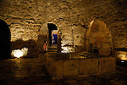 A child (5 years old) stands looking around the crypt below the Cathedral of Saint Mary. Diocletian Palace, Split, Croatia