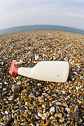 Plastic spray bottle discarded on Cley Beach, Norfolk, United Kingdom