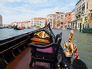 View from the interior of a gondola during a ride on the Grand Canal in Venice