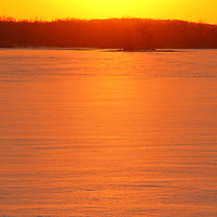"""""""Kissed by the Sun""""<br /> <br /> Just as the sun begins to set, it casts its warm glow over trees in silhouette, and beautiful winter snow. A landscape kissed by the sun!!<br /> <br /> Sunset Images by Rachel Cohen"""