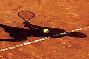 V. 10. Valencia, 11/04/2006. Un tenista le da a la bola durante la segunda jornada del cuadro final del IV Open de Tenis Comunidad Valenciana que tiene lugar hoy en el Club de Tenis de Valencia. EFE/Kai Försterling.