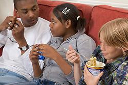 Group of teenagers eating,