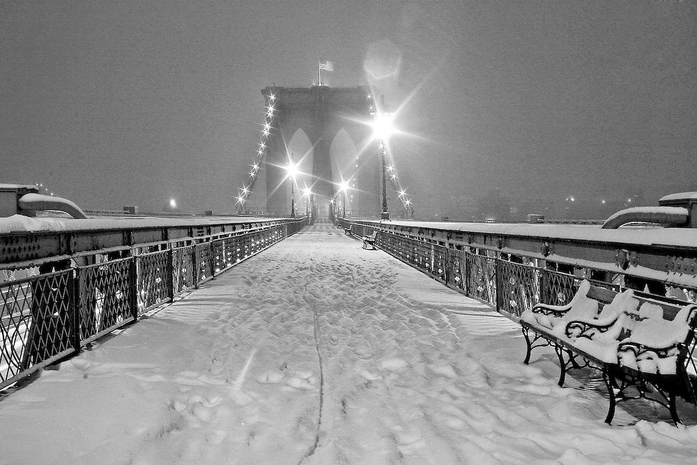New York City: Broklyn Bridge pedestian walkway in a snowstorm