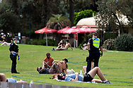 Police question beach goers about their reason for being outside during COVID-19 in Melbourne, Australia. Premier Daniel Andrews comes down hard on Victorians breaching COVID 19 restrictions, threatening to close beaches if locals continue to flout the rules. This comes as Victoria sees single digit new cases. (Photo by Dave Hewison/Speed Media)