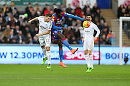 Angel Rangel of Swansea city jumps for a header with Emmanuel Adebayor of Crystal Palace. Barclays Premier league match, Swansea city v Crystal Palace at the Liberty Stadium in Swansea, South Wales on Saturday 6th February 2016.<br /> pic by Andrew Orchard, Andrew Orchard sports photography.