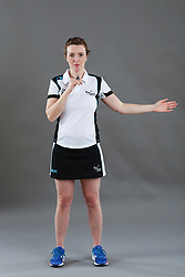 Umpire Louise Travis signalling direction of pass