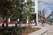Lunchtime people enjoy autumn sunshine outside the new Pret a Manger cafe at Elephant & Castle, south London.