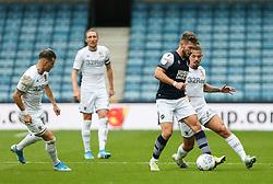 Tom Bradshaw of Millwall holds the ball up under pressure - Mandatory by-line: Arron Gent/JMP - 05/10/2019 - FOOTBALL - The Den - London, England - Millwall v Leeds United - Sky Bet Championship