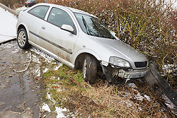 © Licensed to London News Pictures.  03/02/2015. AYLESBURY, UK. Theo Call (not seen), 21, helps recover his crashed car. Theo, who has been driving for a just over a year, skidded going round a corner despite only going 5 miles an hour and ended up stuck in a ditch. <br /> <br /> Thames Valley Police have closed Bishopstone Road near Aylesbury after deeming it too dangerous following a series of accidents and stuck vehicles. Overnight over an inch of snow fell and is causing travel chaos across the region. Photo credit: Cliff Hide/LNP