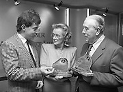 Harry Bradshaw - Christy O'Connor..1986..26.11.1986..11.26.1986..26th November 1986..To commemorate the anniversary of their winning of The Canada Cup in 1956 a presentation was made to Harry Bradshaw and Christy O'Connor. Mr Paul Keogh made the presentation on behalf of,sponsor,Kaliber Lager. The duo won the cup in Mexico City,Mexico.
