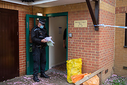 © Licensed to London News Pictures. 03/05/2021. Reading, UK. A police officer maintains a scene watch at the entrance to Belford Court on Luad Close following the death of a woman on Friday 30/04/2021. Thames Valley Police were called to an address on Laud Close, Reading at approximatly 16:30 BST after reports that a 34-year-old woman had died. The death was initially treated as unexplained while officers worked to establish the exact circumstances, but following a post mortem which took place on Sunday 02/05/2021 and gave the cause of death as a blunt force head injury, a murder investigation was formally launched. Photo credit: Peter Manning/LNP