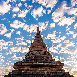 Mystical sunrise in Bagan. The ancient capital of Bagan, a World Heritage site, contains around 3,000 pagodas, temples and Buddhas, including the world's largest reclining Buddha. The magnificent sight is situatiated only some 40 kilometers away from the water junction of the Chindwin ant the Irrawaddy (Ayeyarwady). Usually visitors to come by boat start in Mandalay. Bagan's famous central, arid plain is scattered with over 2,000 surviving ancient temples and pagodas in various states of repair, reflecting the golden age of the powerful Bagan Dynasty between 1044 and 1287.