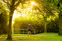 ©Licensed to London News Pictures. 23/09/2019 Aberystwyth UK. UK Weather:  A man walking down  Plascrug Avenue at daybreak on a bright and sunny Equinox morning, September 23 2019, the first day of official autumn in the northern hemisphere. Today the length of the day and night are roughy equal. Photo credit Keith Morris/LNP