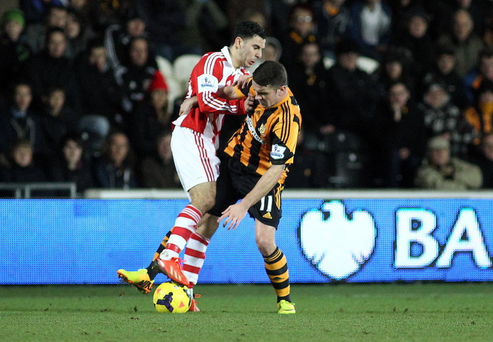Stoke City's Oussama Assaidi vies for possession with Hull City's Robbie Brady<br /> <br /> Photo by Rich Linley/CameraSport<br /> <br /> Football - Barclays Premiership - Hull City v Stoke City - Saturday 14th December 2013 - Kingston Communications Stadium - Hull <br /> <br /> © CameraSport - 43 Linden Ave. Countesthorpe. Leicester. England. LE8 5PG - Tel: +44 (0) 116 277 4147 - admin@camerasport.com - www.camerasport.com