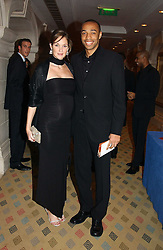 Footballer THIERRY HENRY and his wife NICOLE at a dinner hosted by footballer Patrick Vieira and the Diambars UK Charital Trust at The Landmark Hotel, 222 Marylebone Road, London NW1 on 3rd February 2005.<br />