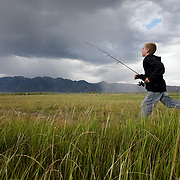A young teenager makes his way to the Owens River near Benton Crossing in the Eastern Sierras. Model released.