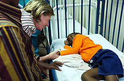 PRETORIA, SOUTH AFRICA - APRIL-26-2004 -.Princess Astrid of Belgium says hello to Emily Mabena, 5, as she visits the childrens ward at the Pretoria Academic Hospital. Before the visit, Princess Astrid attended an signing ceremony where the Belgian governement donated 3.5 million Euros for health care in South Africa. .(PHOTO © JOCK FISTICK)..<br />