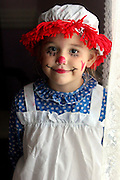 A child dressed up for halloween as Ragedy Ann.