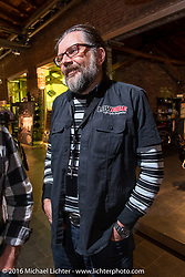 Lowride Magazine Italy editor Giuseppe Roncen at the Harley-Davidson of Cologne dealership party during the Intermot Motorcycle Trade Fair. Cologne, Germany. Tuesday October 4, 2016. Photography ©2016 Michael Lichter.