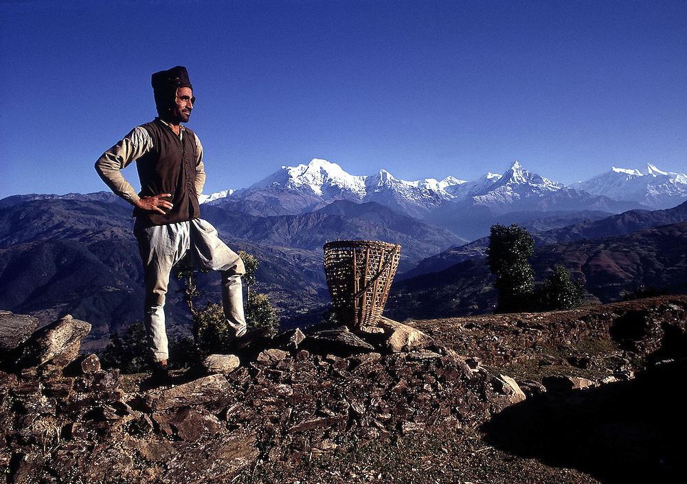 Gurkha Cpl Jang Bahadur Thapa seen near his hilltop home in Shankar Pokari.Annapurna and Dhaulagiri are in the background.Nepal 1969.Photographed by Terry Fincher