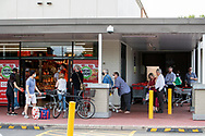 People line up outside Coles at Kurralta Park. New COVID Lockdown Restrictions announced today by the SA Premier Steven Marshall caused panic shopping at supermarkets as people stocked up with essential groceries.   (Photo by Peter Mundy/Speed Media)