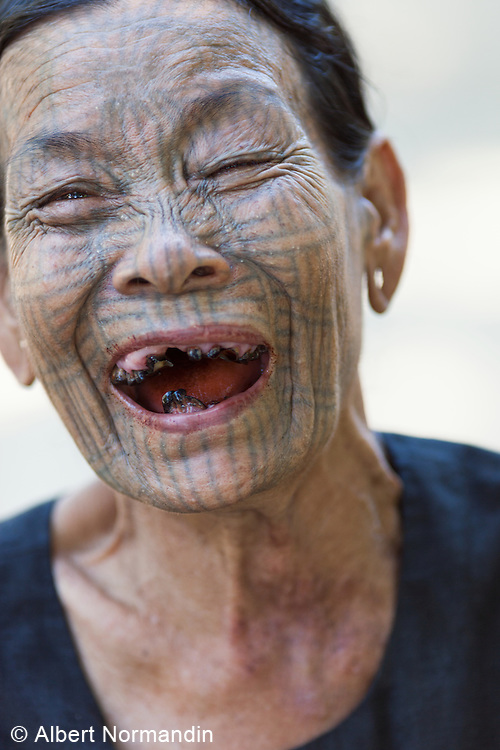 Ma Hein, Tattoo lady laughing, showing her bad missing teeth, Khint Chaung Village outside of  Mrauk U